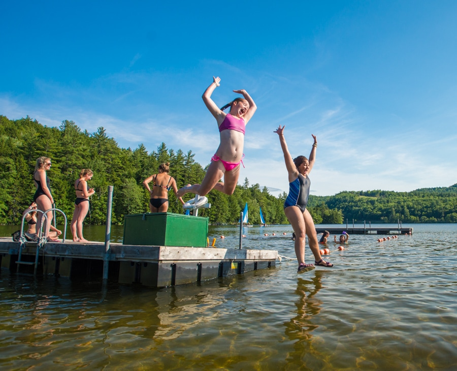 campers-jumping-lake